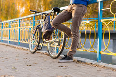 Man with Bike Taking Rest in Park on Autumn Day Stock Photos