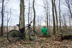 Man with bike in wild forest Royalty Free Stock Images