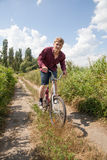 Man on bike Stock Image