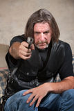 Man in Biker Gang Vest with Gun Stock Photography