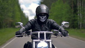 A man biker riding a motorcycle wearing black clothes and helmet. stock video footage