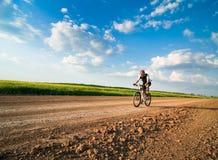 Man biking. Man extreme biking at sunset Royalty Free Stock Photos