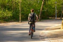 Man biking in the Amsterdam Vondelpark. royalty free stock image