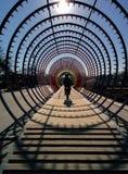 A man biking through arcs. Royalty Free Stock Photos