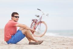 Man biking at the beach Stock Photography