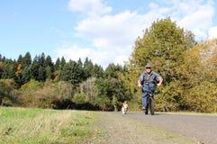 Man biking with dog Royalty Free Stock Photo