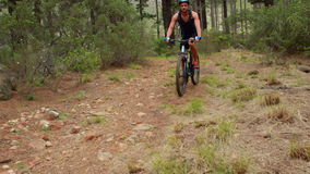 Man biking through a forest. In the countryside stock video footage