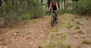 Man biking through a forest. In the countryside stock footage