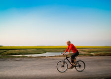 Man biking in motion Stock Photo