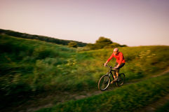 Man biking in motion Stock Photos