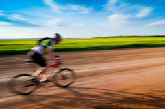 Man biking in motion Royalty Free Stock Photo