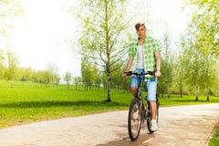 Man biking in park Royalty Free Stock Image