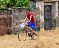 A man biking on rural road in Phu Tho, Vietnam Royalty Free Stock Image