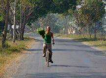 A man biking on rural road in Shan, Myanmar Stock Photography
