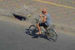 A man biking on street in Saigon, Vietnam stock photo