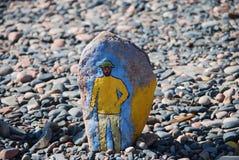 man Bild på en sten Fotografering för Bildbyråer