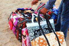 Colorful bag at sea beach. Man binding the heap of colorful bag at sea beach stock image