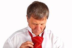 Man binding his tie Royalty Free Stock Image
