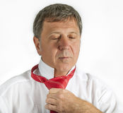 Man binding his tie Stock Photos