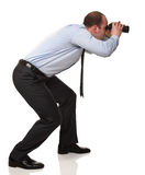 Man with binocular. Active businessman with binocular isolated on white royalty free stock image
