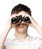 Man with binocular. Towards white background Stock Images