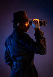 Man with binocular Royalty Free Stock Images