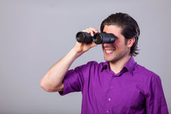 Man with binocular Stock Images