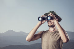 Man with binocular in the mountains Royalty Free Stock Images