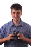 Man with binocular smiling Royalty Free Stock Photography