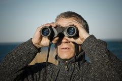 A man with binoculars royalty free stock photos