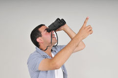 Man with binoculars Stock Photography