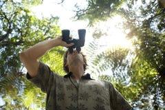 Man with Binoculars Stock Photo