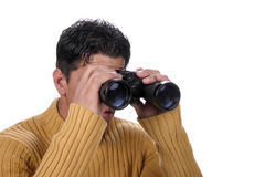 Man with binoculars. Johnny Barber Modeling Stock Shots Royalty Free Stock Image