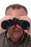Man With Binoculars. Man looking through binoculars; isolated on white; see two other versions for added special effect of eyeballs visible in lens of binoculars royalty free stock photos