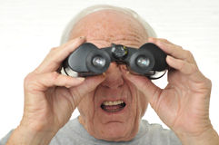 Man with binoculars is confused with results Royalty Free Stock Photography