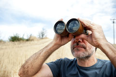 Man with  binoculars Royalty Free Stock Photos