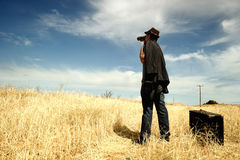 Man with binoculars in a field stock image