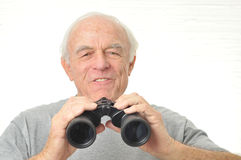 Man with binoculars is frustrated with results Stock Images