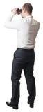 Man with binoculars Stock Image
