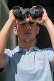 Man with binoculars. Stock Photography