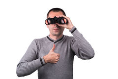 Man with binoculars. Young boy looking through binoculars and holding thumbs up on a white background Stock Photography