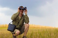 Man with binoculars Royalty Free Stock Photography