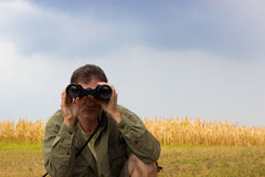 Man with binoculars Royalty Free Stock Photo