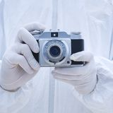 Man in biohazard with camera Royalty Free Stock Image