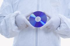 Man in biohazard suit with CD Stock Image
