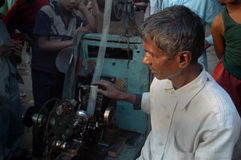 Man with a bioscope. Man showing movie clips to children through a hand controlled bioscope during Muharram in India Stock Images