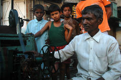 Man with a bioscope. Man showing movie clips to children through a hand controlled bioscope during Muharram in India Royalty Free Stock Image