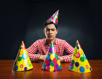Man with Birthday hats Stock Photos