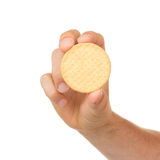 Man with a biscuit in his hand Stock Image