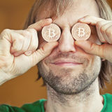 Man with Bitcoins Stock Image